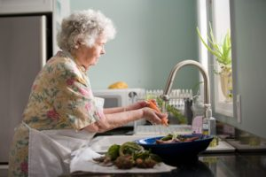 woman washes vegetables to prepare a healthy meal